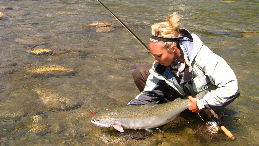 Hot fishing girl with trout - Drowning Worms